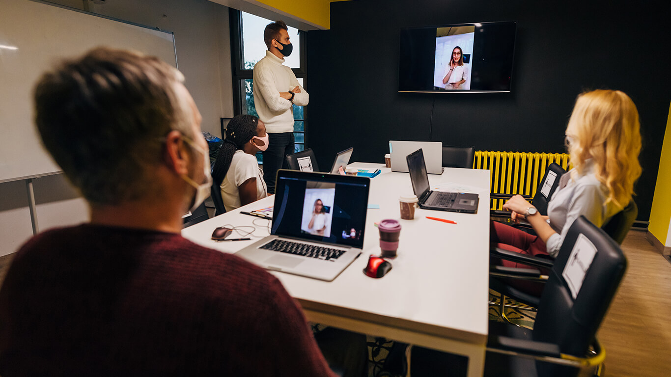 conference room with a video call in progress